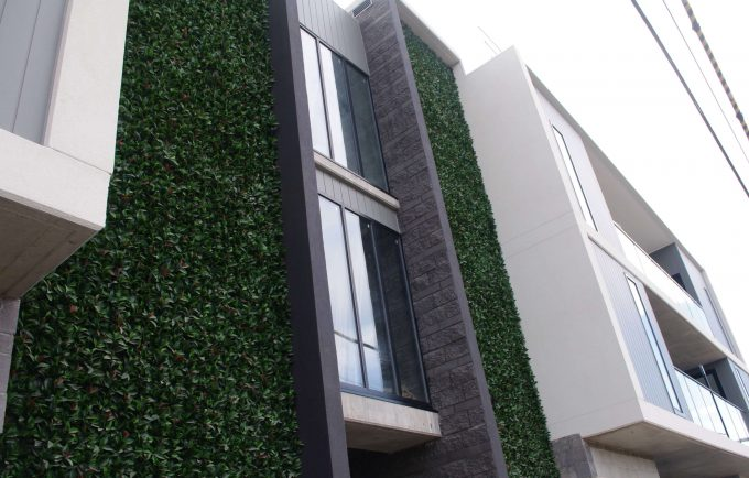 Artificial plant wall for a commercial development