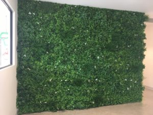 Office wall with white oasis vertical garden artificial green wall