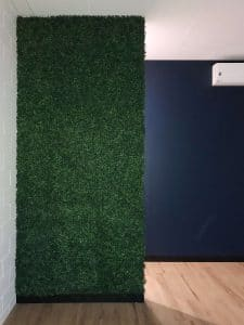 Artificial boxwood wall installed into an office