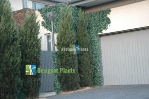 Artificial Hedges / Ivy panels have been applied and cut to size