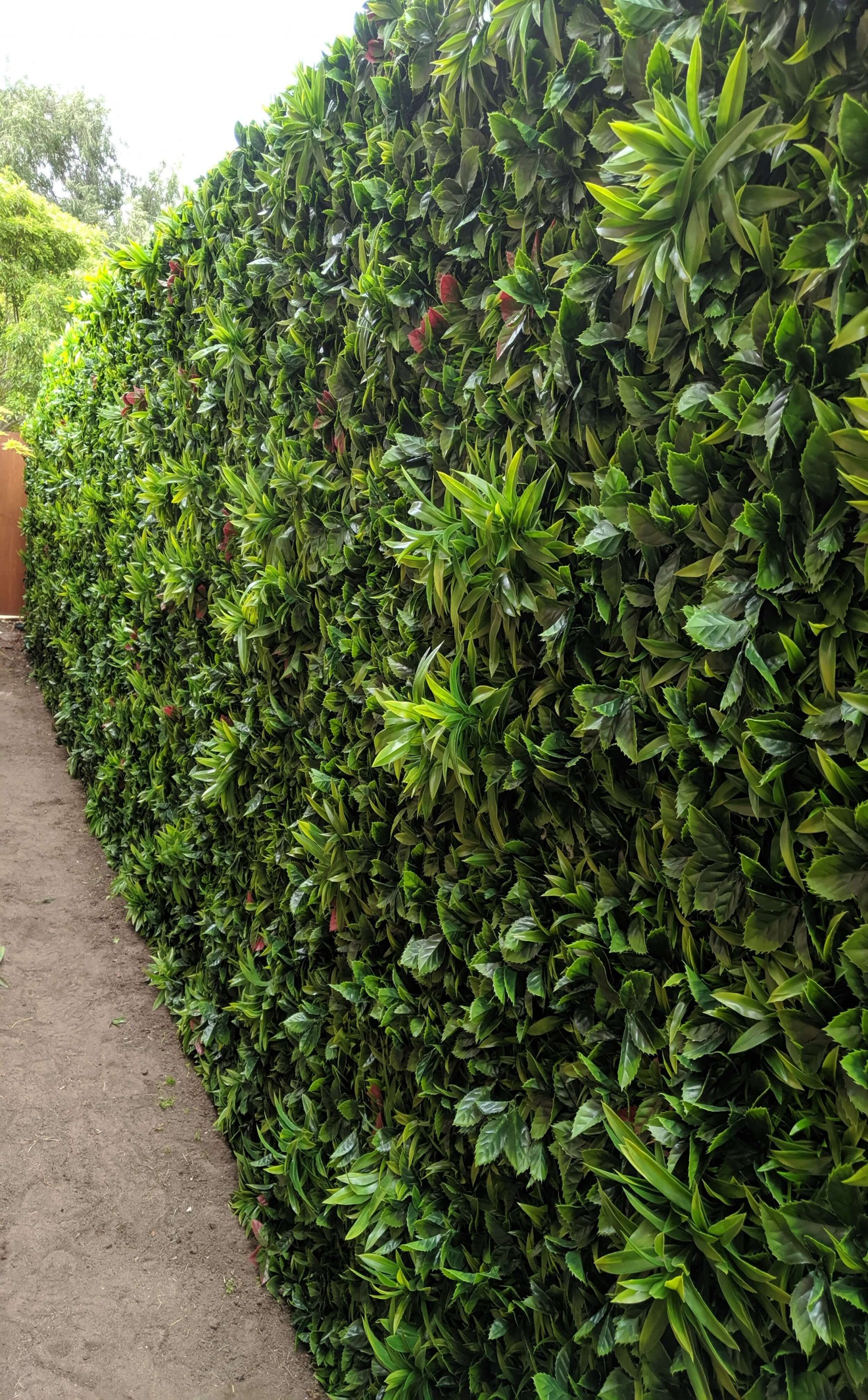 foam wall with green meadows fake hedge