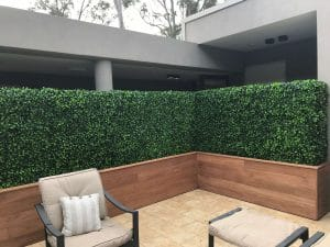 Artificial jasmine hedges in stunning timber planters