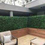 Custom made timber planters with artificial hedge to screen of an area