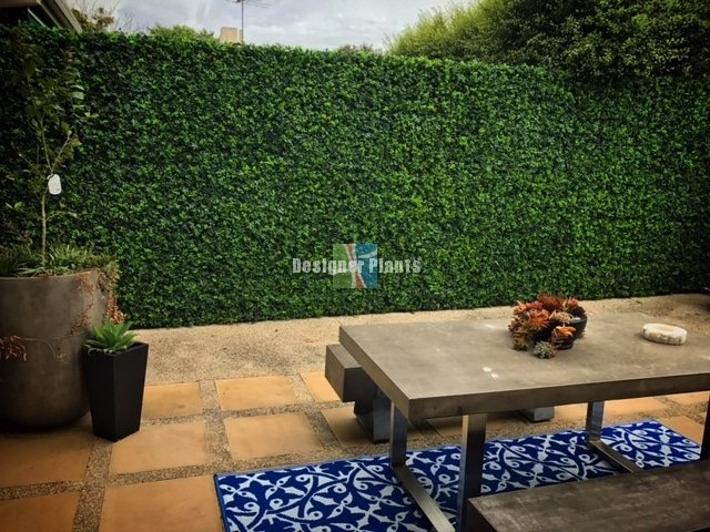 Backyard Transformation with Artificial Plants and Vertical Garden Panel