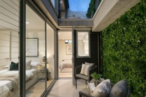Stunning white oasis vertical garden used to sell a home