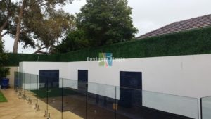 artificial boxwood hedge on a pool side trellis