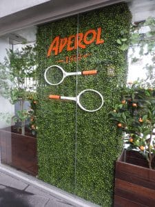 Artificial boxwood hedge used for a public event with tennis rackets