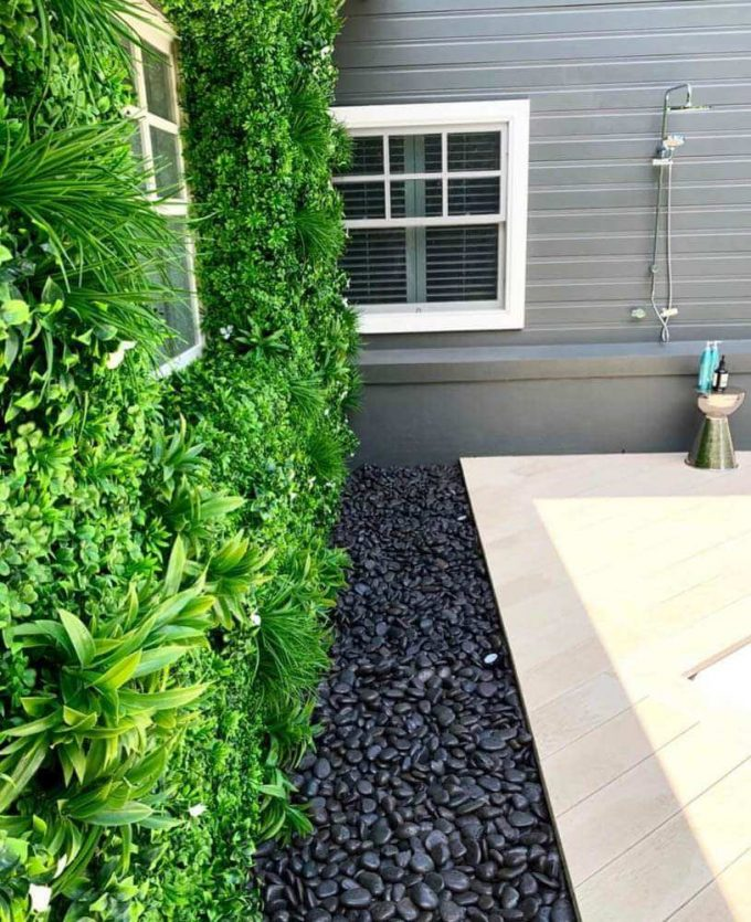 White oasis vertical garden on a house wall