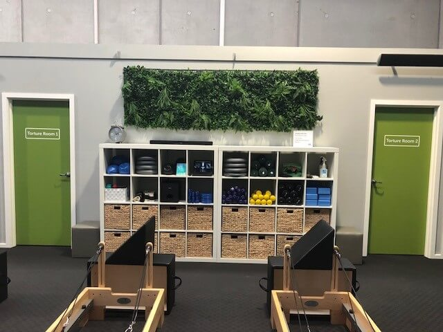 Artificial green wall for a warehouse and retail shop fitout