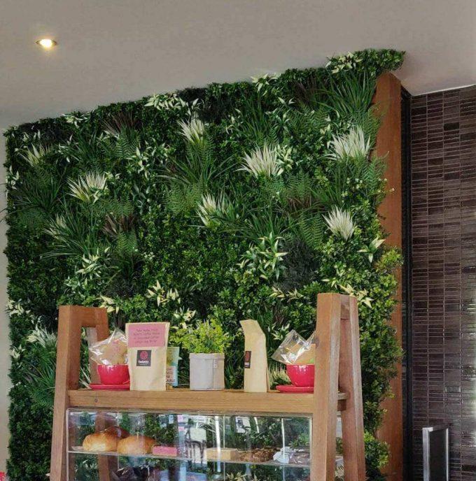 retail shop with tropical fern vertical garden panel