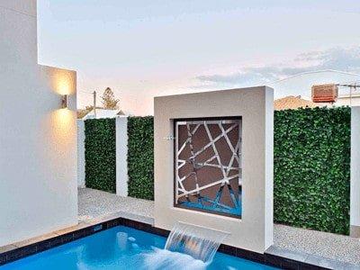 Artificial Vertical Garden next to resident pool