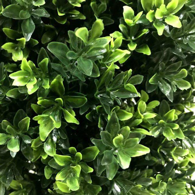 close of artificial shrub leaves