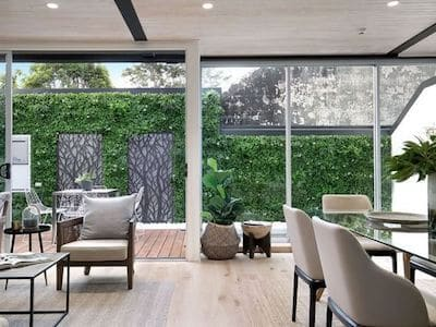 An artificial vertical garden makes for a stunning view from within a home