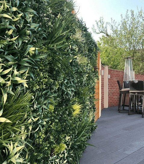 artificial premium green wall with fake grasses