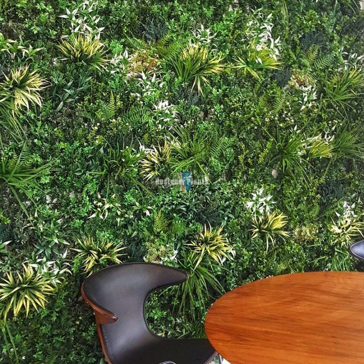 Fake green wall inside an office