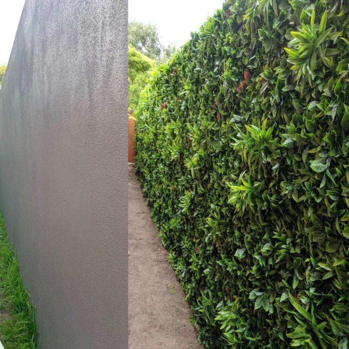 fake green meadow fake hedge wall