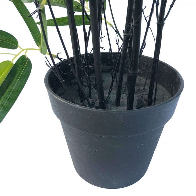 pot of an artificial bamboo plant with black trunks