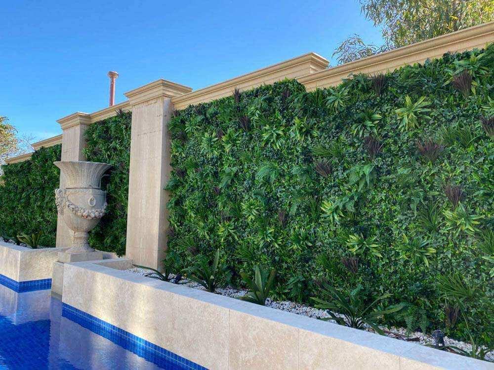 fake green wall panels along a fence