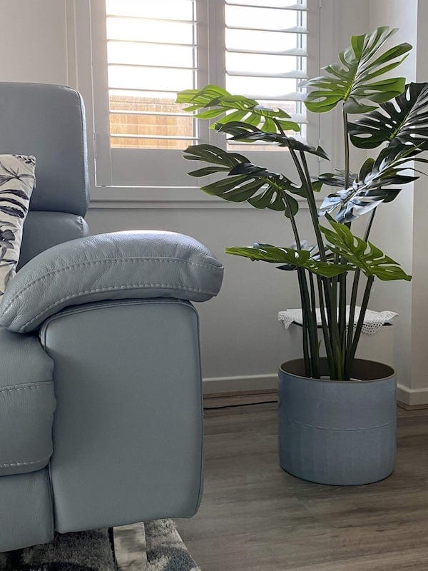 This realistic artificial split philodendron plant adds an elegant and modern touch to any space