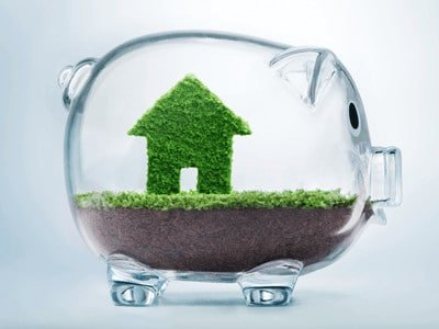 Your guide to a more eco-friendly home - green home with soil and piggy bank