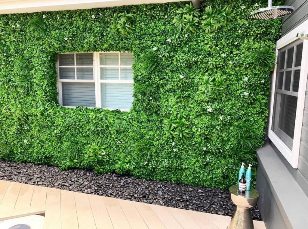 External wall covered in white oasis green wall panels