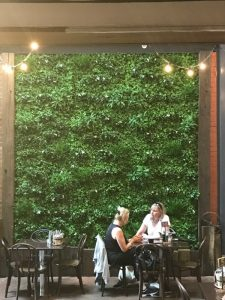 Artificial 1m x 1m vertical garden panel in modular format with flowers. A stunning fake hedge panel