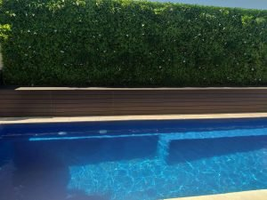 Pool fence with white oasis green wall pools