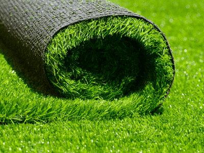 Roll of artificial grass on floor - Pros and cons of artificial grass