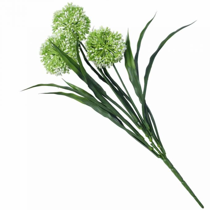 flowering fake plant with white flowers and green grass