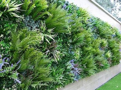 Outdoor artificial green wall by designer plants