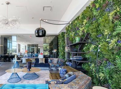 Penthouse with custom artificial green wall by Designer Plants