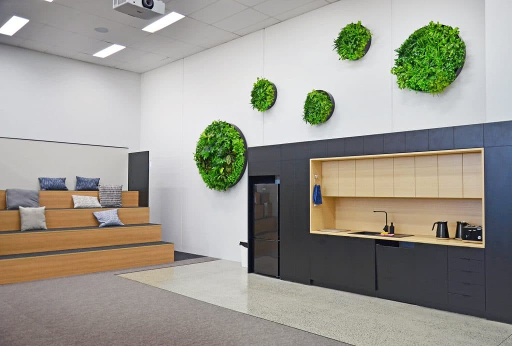 green wall discs installed in a warehouse