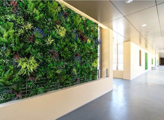Carpark walk way with fake plant wall
