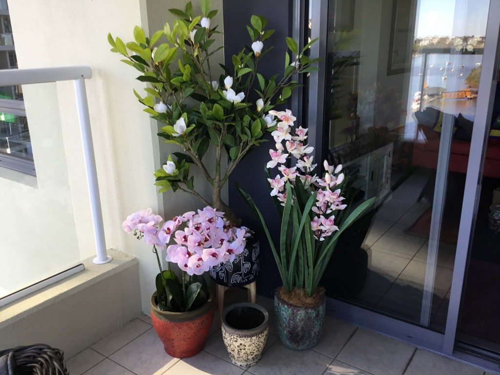 potted artificial plants and fake orchid