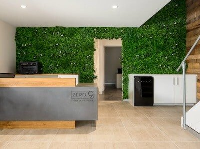 A modern office entryway fit out with artificial green wall