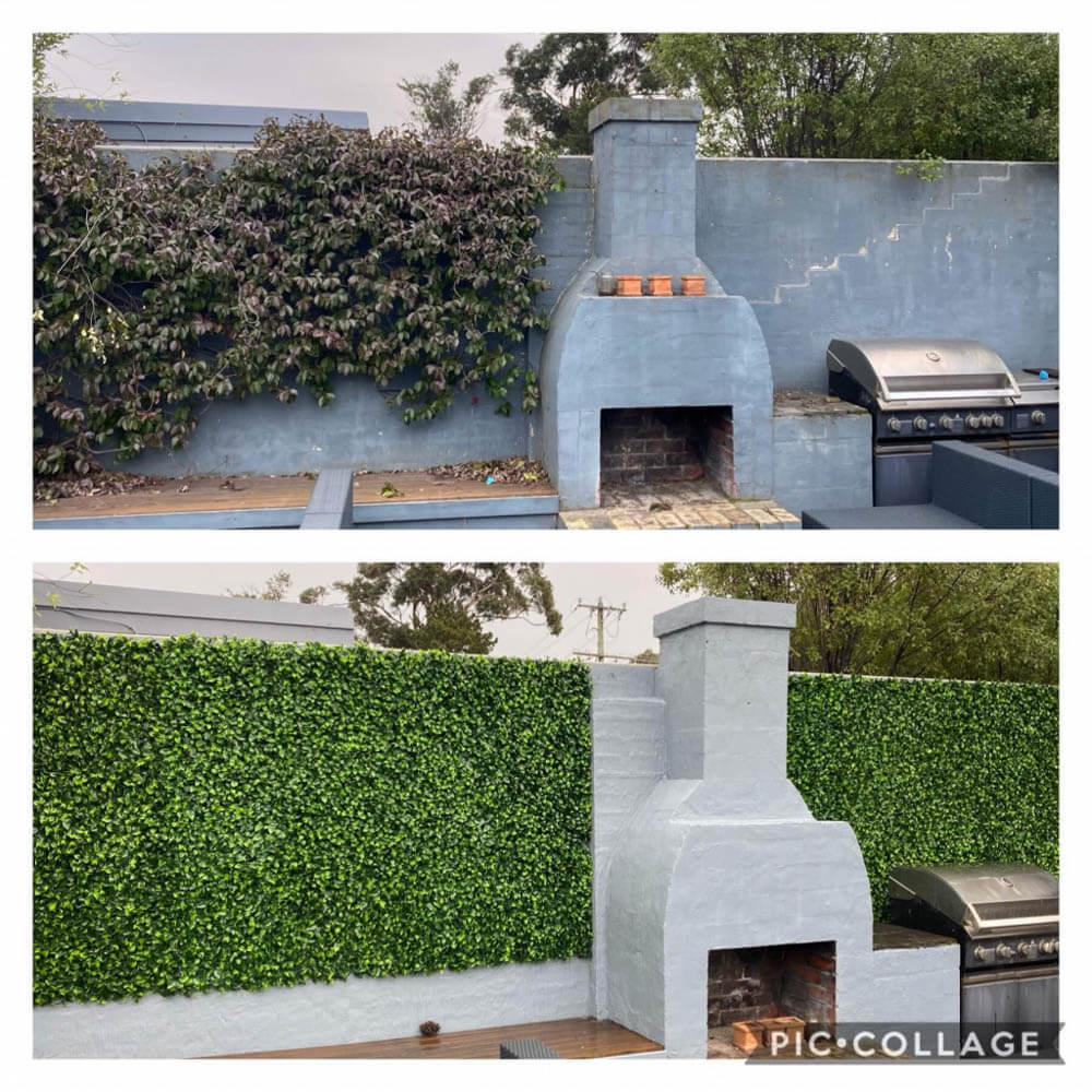 fake hedge panels installed onto a brick wall