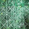 backing of artificial hedge panels