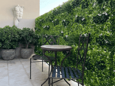 Art and sculpture really add characted to a small garden space.