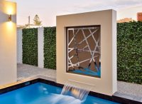 Artificial Ivy Hedge Screen Installed Near A Pool